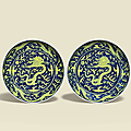 A pair of underglaze-blue and yellow-enamelled 'Dragon' dishes, Guangxu six-character marks in underglaze-blue and of the period (1875-1908)
