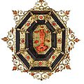 A gilt bronze and copper, enamels, coral and wood capezzale, trapani, 18th century