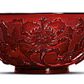 A carved transparent red glass bowl, <b>Qianlong</b> <b>incised</b> <b>four</b>-<b>character</b> <b>mark</b> within a square <b>and</b> <b>of</b> <b>the</b> <b>period</b> (1736-1795)