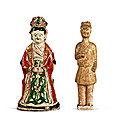 A <b>Cizhou</b> painted figure of a lady, Southern Song - Jin dynasty, and a straw-glazed figure of a groom, Tang dynasty