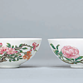 A pair offamille rosebowls; The porcelain Yongzheng six-character marks within double circles and of the period (1723-1735), the enamels later