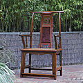 An exceptional and rare huanghuali yokeback armchair with 'fu' character and burl splat, Late Ming dynasty, <b>16th</b>-<b>17th</b> <b>Century</b>