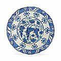 An early iznik blue and white pottery dish.ottoman turkey, circa 1530