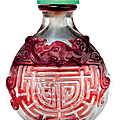 A red glass overlay 'Shou'character snuff bottle, Qing dynasty (1644-1911)