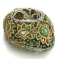 A Mughal <b>gem</b>-<b>set</b> <b>and</b> <b>enamelled</b> <b>gold</b> archer's ring, North India, circa 18th-19th century