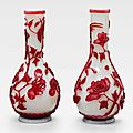 A pair of red overlay white glass vases, 19th century