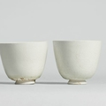 Two glazed white stoneware cups, Sui-<b>Tang</b> dynasty