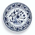 A blue and white '<b>Lotus</b> Bouquet' dish, Ming dynasty, Yongle period (1403-1424)