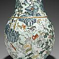 A large famille rose molded 'Hundred-deer' vase,<b>hu</b>, Qing dynasty (1644-1911)