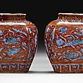 A small pair of blue and white and later red enamelled jars, ming dynasty, 16th century