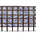 A blue and white porcelain-inlaid hardwood <b>eight</b>-leaf screen, 19th century