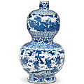 An exceptionally rare <b>and</b> large blue <b>and</b> white 'Immortals' double-gourd vase, <b>Jiajing</b> <b>six</b> <b>character</b> <b>mark</b> <b>and</b> <b>of</b> <b>the</b> <b>period</b>
