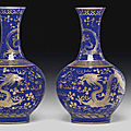 A pair <b>of</b> gilt-decorated blue-ground bottle vases, <b>Guangxu</b> <b>six</b>-<b>character</b> <b>marks</b> in gilding <b>and</b> <b>of</b> <b>the</b> <b>period</b> (1875-1908)