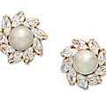 A pair of natural pearl and diamond ear clips, by <b>Bvlgari</b>