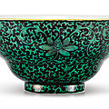 A <b>black</b>-<b>ground</b> <b>green</b>-<b>enamelled</b> 'lotus' ogee bowl, Seal mark and period of Qianlong (1736-1795)