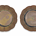 A rare pair of small brown-glazed saucer dishes, 11th-12th century
