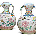 A magnificent pair offamille rose'butterfly' double-gourd <b>vases</b>, Qianlong six-character seal marks and of the period