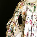Detail of the back of a robe à la française made in England from Chinese painted silk, <b>c</b> <b>1770s</b>