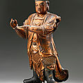 A gilt-lacquered wood figure of an attendant deity, Ming dynasty (1368-1644)