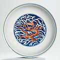 An <b>iron</b>-<b>red</b> <b>and</b> <b>underglaze</b>-<b>blue</b> <b>decorated</b> 'Dragon' dish, Qianlong six-character seal mark in <b>underglaze</b> <b>blue</b> <b>and</b> of the period