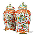 A large pair of Chinese iron-red-ground famille verte <b>baluster</b> <b>vases</b> and covers, 19th century