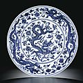 A magnificent blue and white '<b>dragon</b>' <b>dish</b>. Mark and period of Xuande (1426-1435)