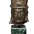 A stone head of guanyin, china, ming dynasty (1368-1644)