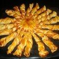 Pizza soleil torsadée pour l'apéritif ( au jambon et aux tomates )