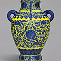 A rare <b>yellow</b>-<b>ground</b> <b>underglaze</b>-<b>blue</b> 'lotus' archaistic vase, Qianlong seal mark and period (1736-1795)