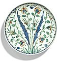 An iznik rimless polychrome pottery dish, turkey, circa 1560-70
