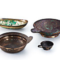 Two parcel-<b>gilt</b> silver alloy vessels, a silver alloy oval basin and a parcel-<b>gilt</b> <b>bronze</b> pouring vessel, Tang dynasty (618-907)