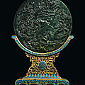 A spinach-green jade circular <b>table</b> screen and a cloisonné enamel stand, Qing dynasty, Qianlong period (1736-1795)