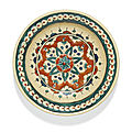 An Iznik polychrome pottery dish with a stylised stellar floral motif, Turkey, <b>circa</b> <b>1580</b>-90