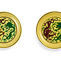 A pair of green and aubergine-enamelled yellow-ground '<b>dragon</b>' dishes, Marks and period of Kangxi (1662-1722)