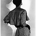 <b>Suzy</b> <b>Parker</b> modeling a Balenciaga dress at the Paris collections, Vogue 1952