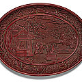A rare <b>and</b> finely carved cinnabar lacquer dish, <b>Yongle</b> <b>mark</b> <b>and</b> <b>period</b> (<b>1403</b>-<b>1424</b>)