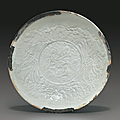 A molded <b>Qingbai</b> 'Phoenix' bowl, Southern Song Dynasty (1127-1279)