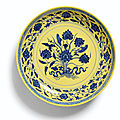 A blue and yellow '<b>lotus</b> bouquet' dish, Seal mark and period of Qianlong (1736-1795)