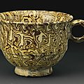 A rare yellow-glazed marbled pottery cup, Tang dynasty (AD 618-907)