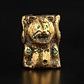 A turquoise-inlaid gilt-bronze 'bear' fitting, Han dynasty (206 BC-220 AD)