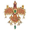 A gem-set gold <b>pendant</b> in the form of an eagle, Deccan or South India, 19th century