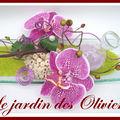 composition florale orchidées et bulles de verre