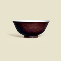 A fine aubergine-glazed <b>incised</b> 'Dragon' <b>bowl</b>, Daoguang six-character seal mark in underglaze blue and of the period (1821-1850)