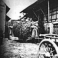 1865 Cour de ferme en Alsace, une charette de foin