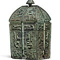 A rare finely cast bronze ritual wine vessel and cover, <b>fangyi</b>, Shang dynasty, 13th-11th century BC