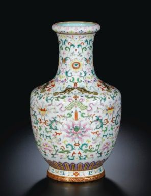 A Famille-Rose 'Twin Fish And Chime' Vase. Qing Dynasty, 18th Century