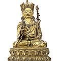 A gilt-copper figure of <b>Padmasambhava</b>, Tibet, circa 15th century