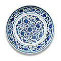 A <b>Ming</b>-<b>style</b> blue and white 'floral scroll' dish, Yongzheng six-character mark and of the period (1723-1735)