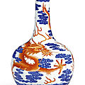 A magnificent and extremely rare <b>iron</b>-<b>red</b> and underglaze-blue 'Dragon' bottle vase, Seal mark and period of Qianlong (1736-1795