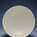 A magnificent and superbly carved large Ding 'Fish' bowl, Northern Song dynasty (960-1127)